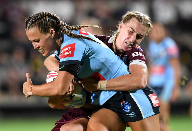 Maroons captain Ali Brigginshaw (right) tackles Centre for NSW Women is number 4Isabelle Kelly