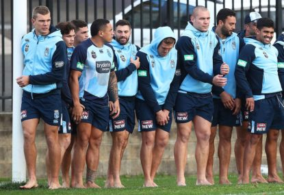 Blues players take part in a drill in bare feet