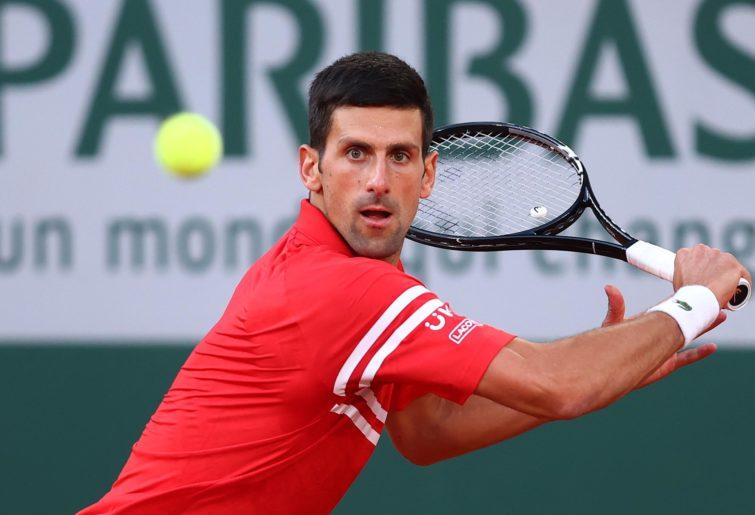 Novak Djokovic lines up his shot