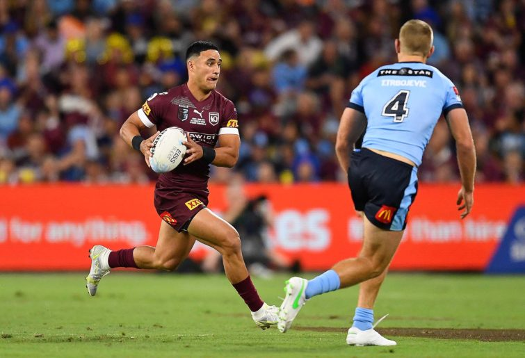 Valentine Holmes of the Maroons runs the ball