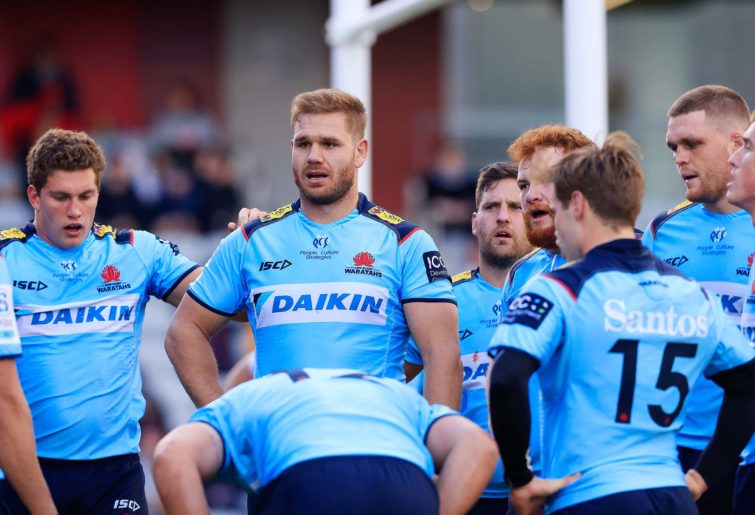 The Waratahs after conceding a try