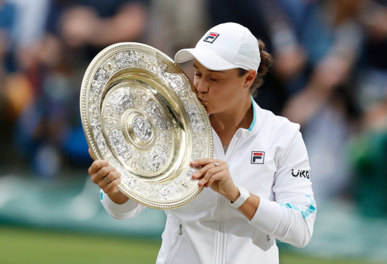 Ashleigh Barty kisses the Venus Rosewater Dish after winning Wimbledon.