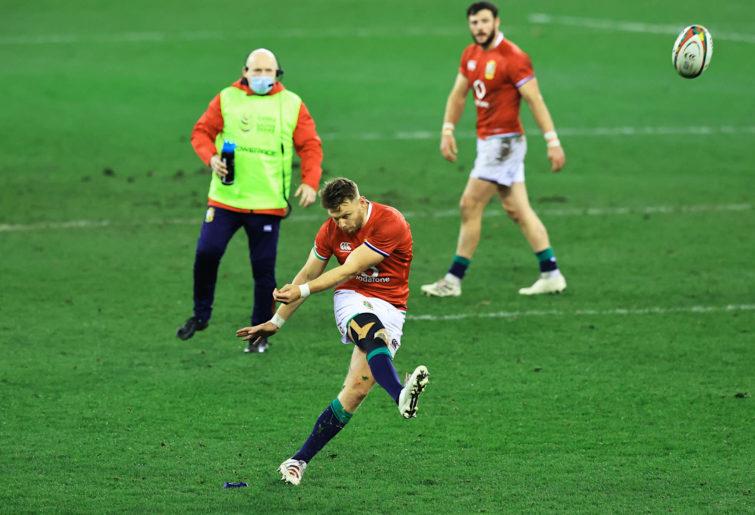 Dan Biggar kicks a penalty during the first Test
