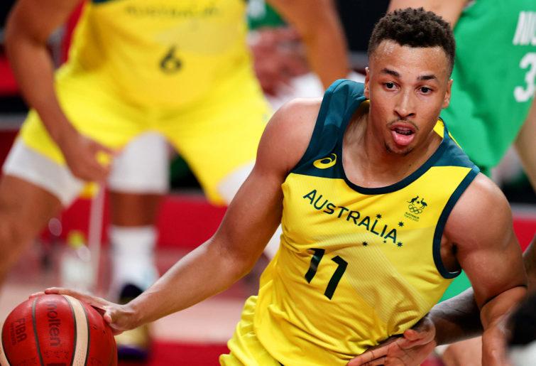 Dante Exum of the Australian Boomers dribbles the basketball