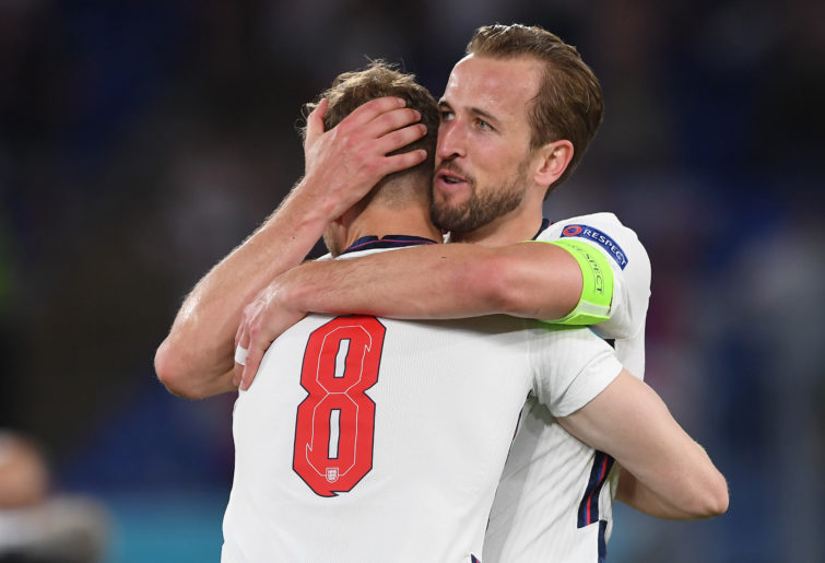Harry Kane celebrates with Jordan Henderson.