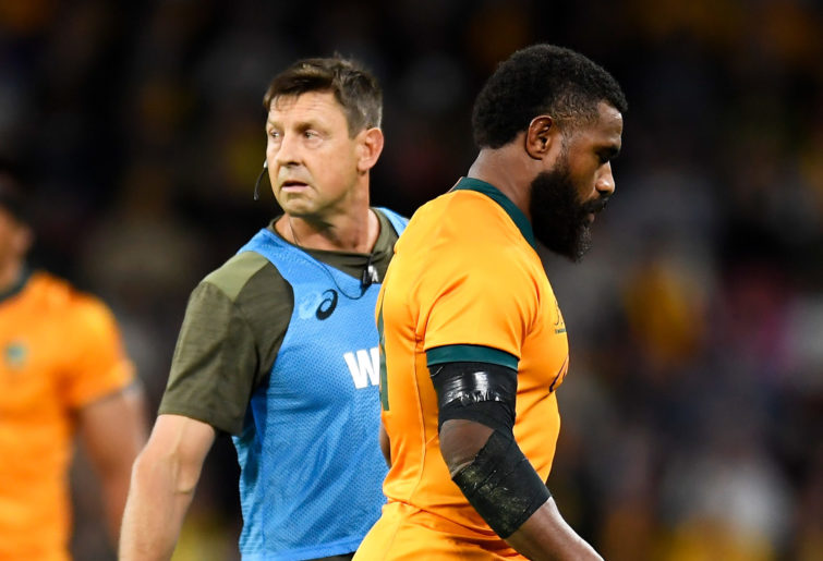 Marika Koroibeteof the Wallabies looks dejected as he leaves the field after being given a red card