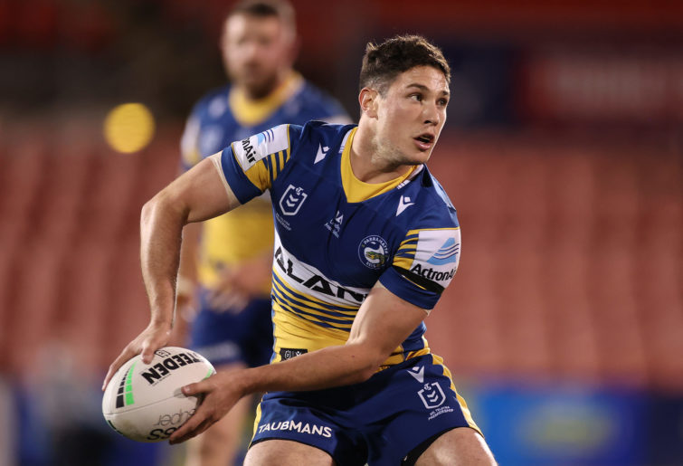 Mitchell Moses offloads the ball.