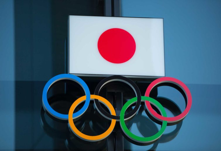 The Japanese National Flag over the Olympic Rings symbol