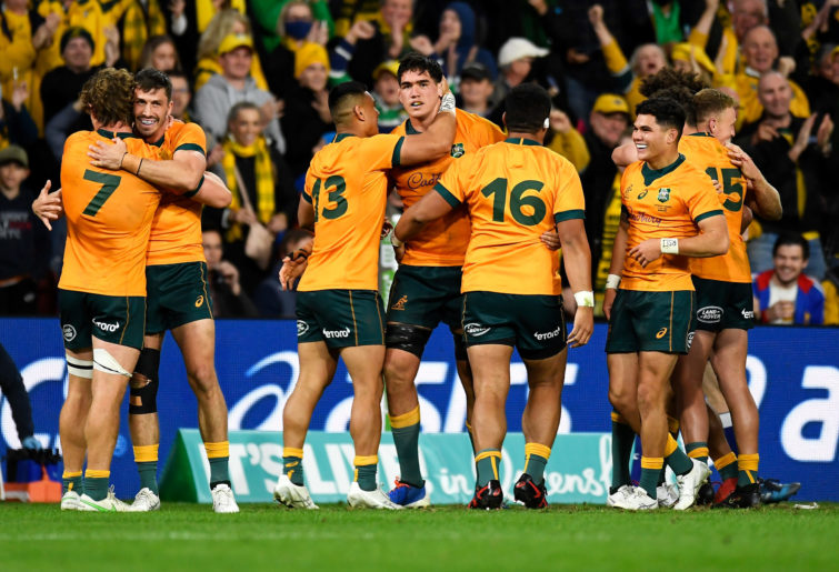 The Wallabies celebrate victory.