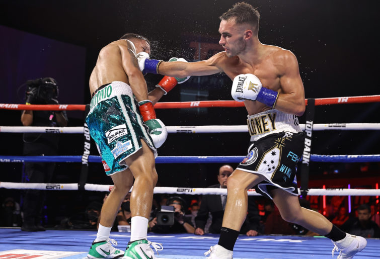 Joshua Franco (L) and Andrew Moloney (R) exchange punches during their fight for the WBA super flyweight championship.