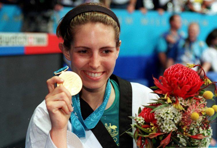 Lauren Burns of Australia with the Gold Medal she won