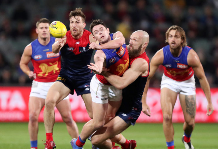 Lachie Neale of the Lions handpasses the ball