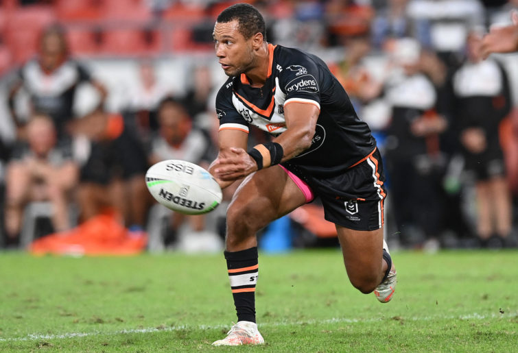 Moses Mbye of the Tigers offloads the ball