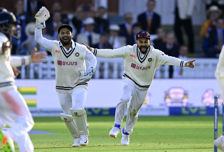 Rishabh Pant and Virat Kohli of India celebrate the final wicket and winning the Second LV= Insurance Test Match