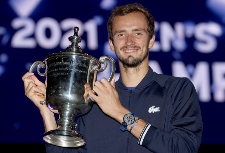 Daniil Medvedev of Russia celebrates with the championship trophy