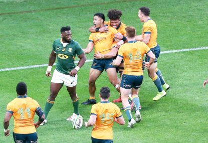 Len Ikitau of the Wallabies scores a try