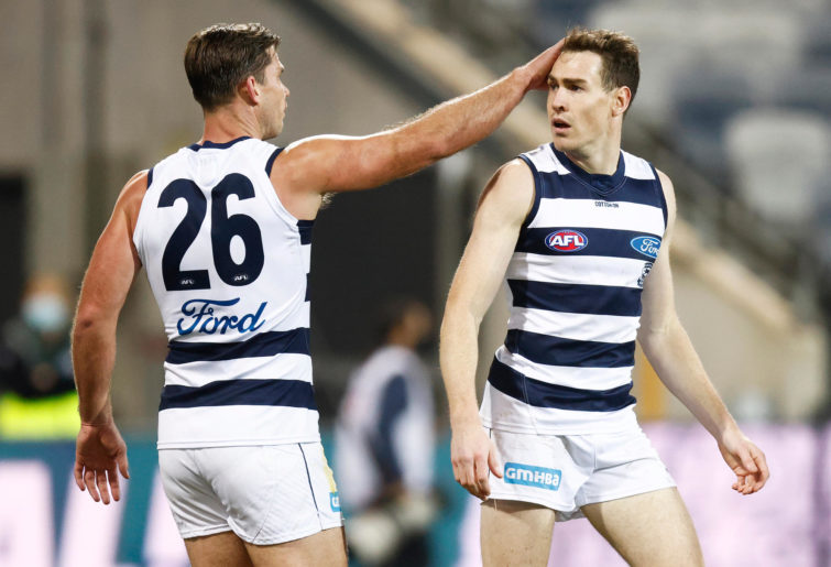 Jeremy Cameron of the Cats (R) celebrates a goal with Tom Hawkins