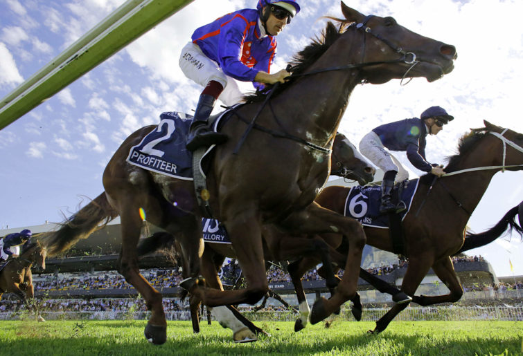 Hugh Bowman on Profiteer competes in the Golden Slipper