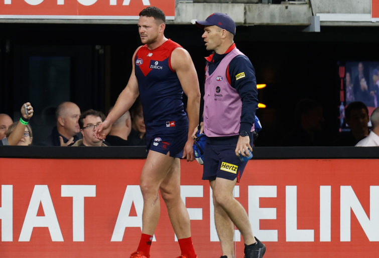 Steven May leaves the ground with an injury during Melbourne's preliminary final win.