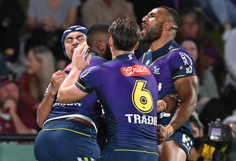 Isaac Lumelume of the Storm celebrates with teammates after scoring a try during the NRL Qualifying Final between the Melbourne Storm and the Manly Sea Eagles.