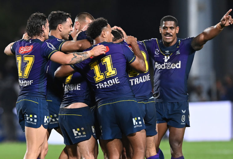 Storm players celebrate winning the NRL Qualifying Final.