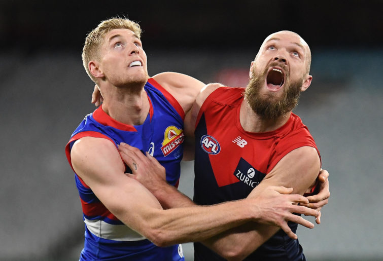 Tim English of the Bulldogs and Max Gawn of the Demons compete for the bal;