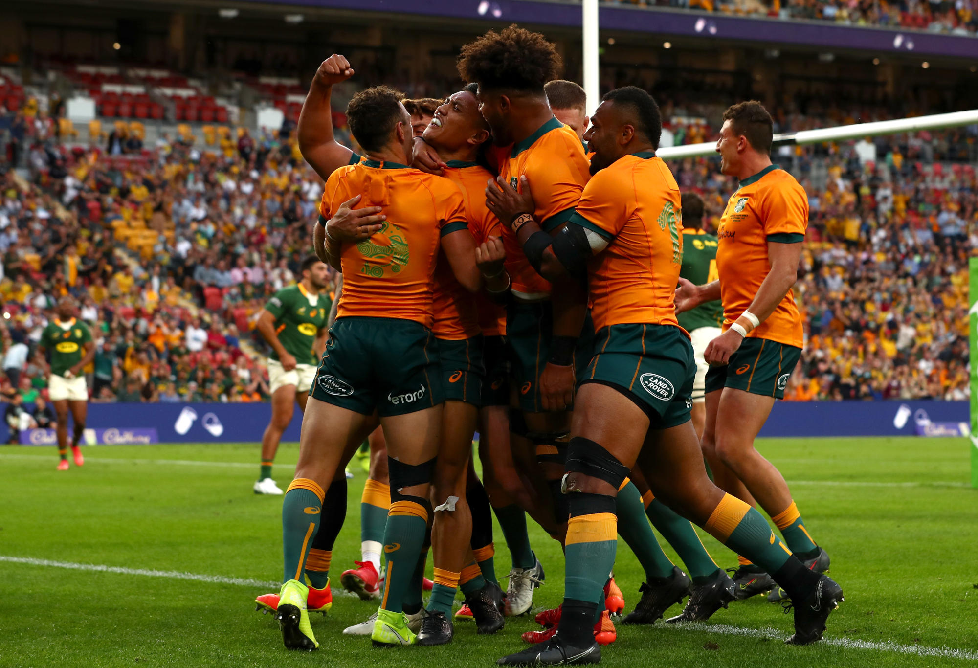 Len Ikitau of the Wallabies celebrates after scoring a try
