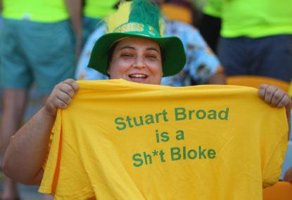 An Australian supporter wearing a Stuart Broad T-shirt poses