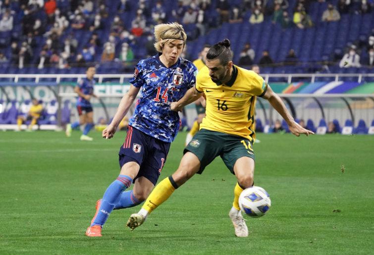 Aziz Behich of Australia controls the ball under pressure