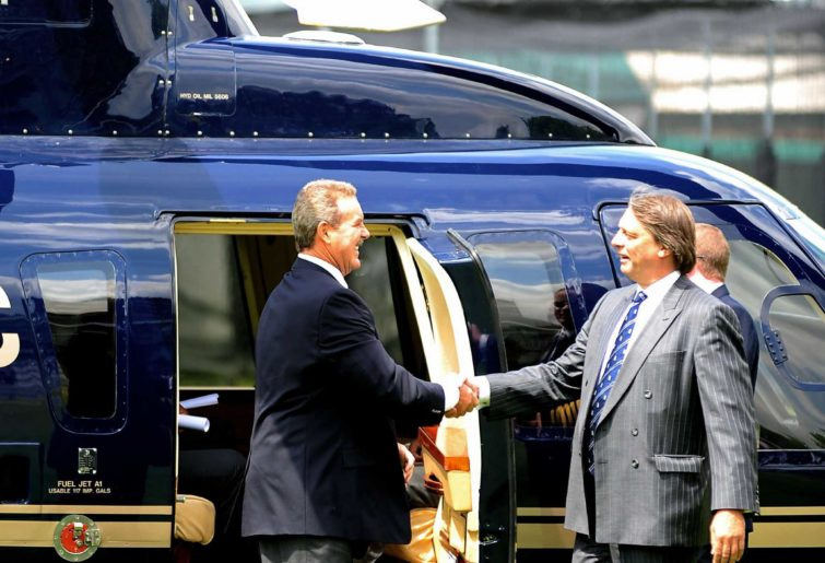 Sir Allen Stanford (left) arrives at Lord's via helicopter.