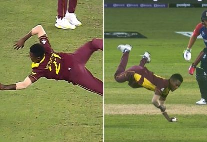 Classic catch, or a drop? Windies spinner's controversial one-hander divides cricket world